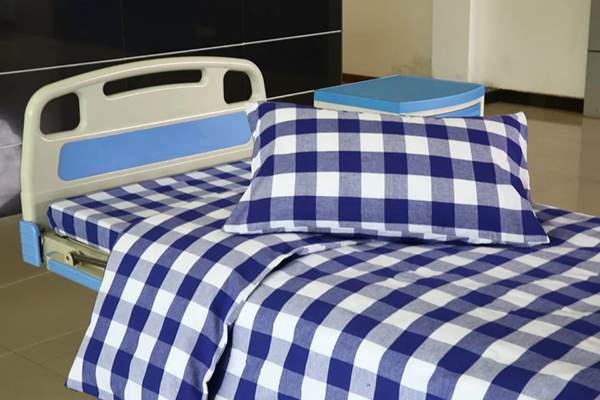 blue white check hospital bed sheet